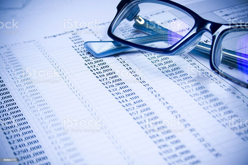 financial statement and glasses royalty-free stock photo