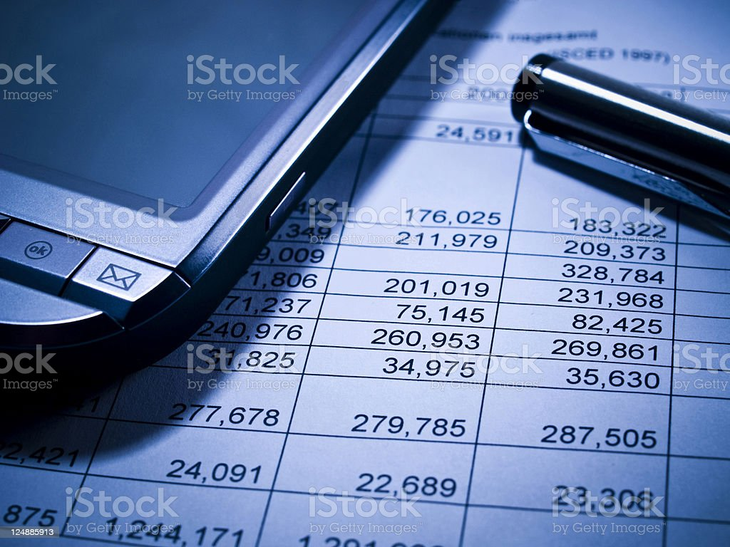 Financial statement and PDA stock photo