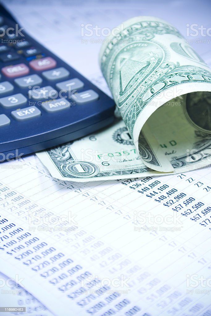financial statement and US currency. royalty-free stock photo