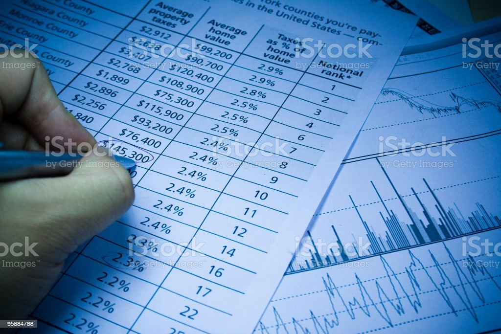 financial statement and writing hand royalty-free stock photo