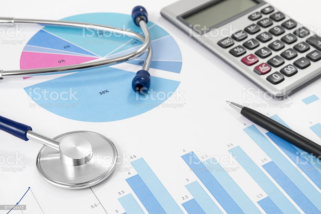Financial Statement with Stethoscope and Calculator stock photo