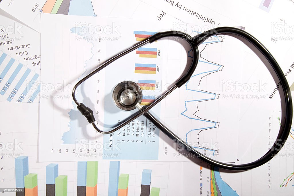 Financial statement with stethoscope stock photo