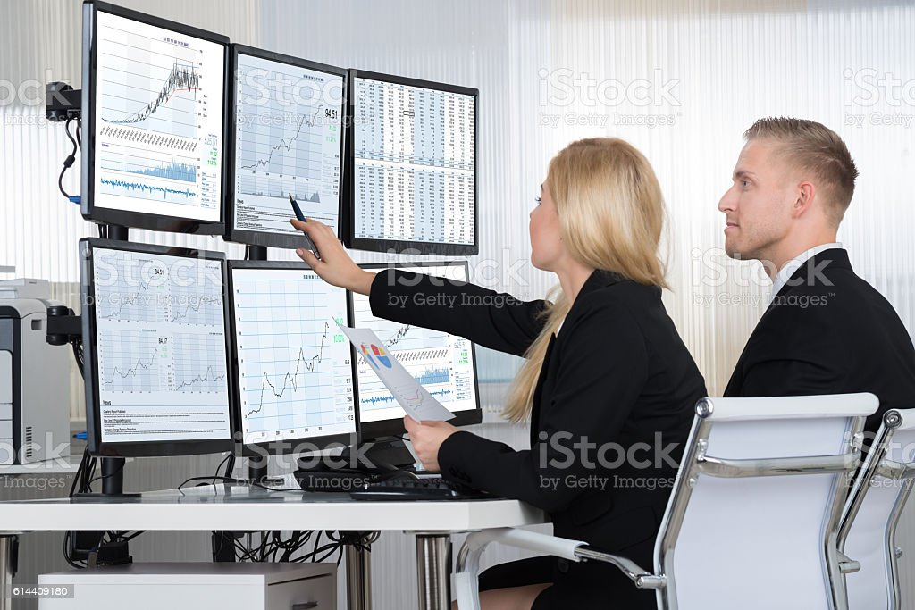Financial Workers Analyzing Data In Office stock photo