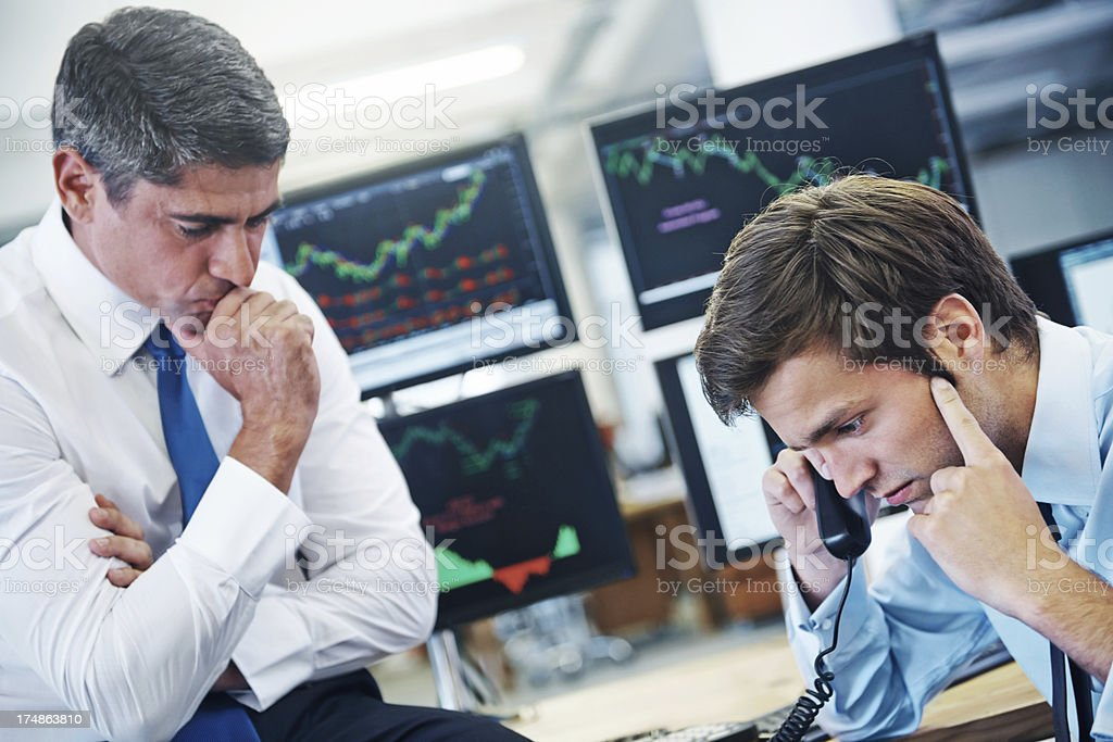 Financial worry etched on their faces stock photo