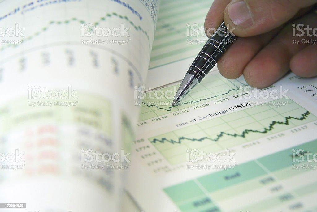 Financier checks financial documents stock photo