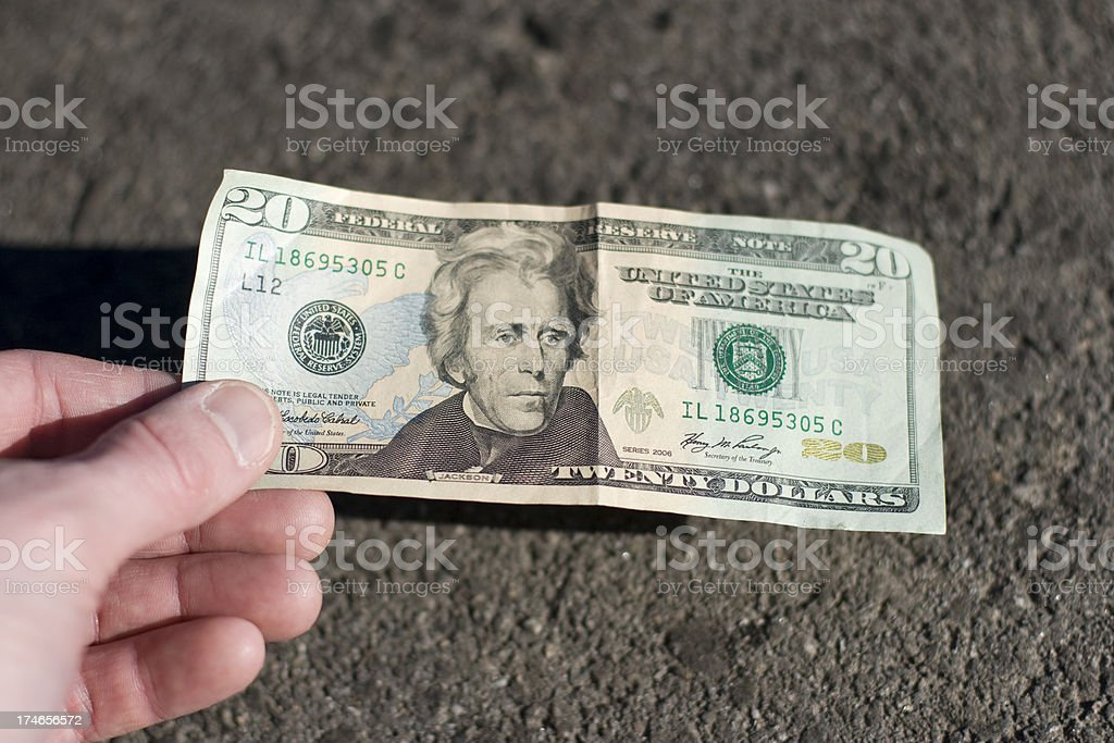 Find a 20$ bill on the street royalty-free stock photo