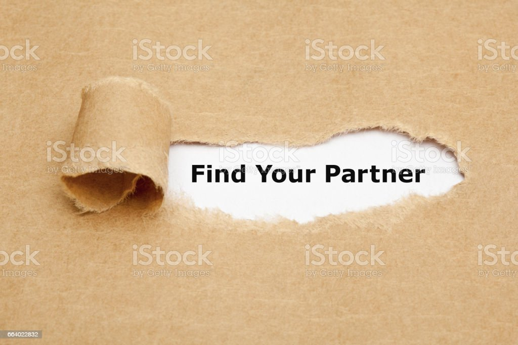 Find Your Partner Behind Torn Paper stock photo