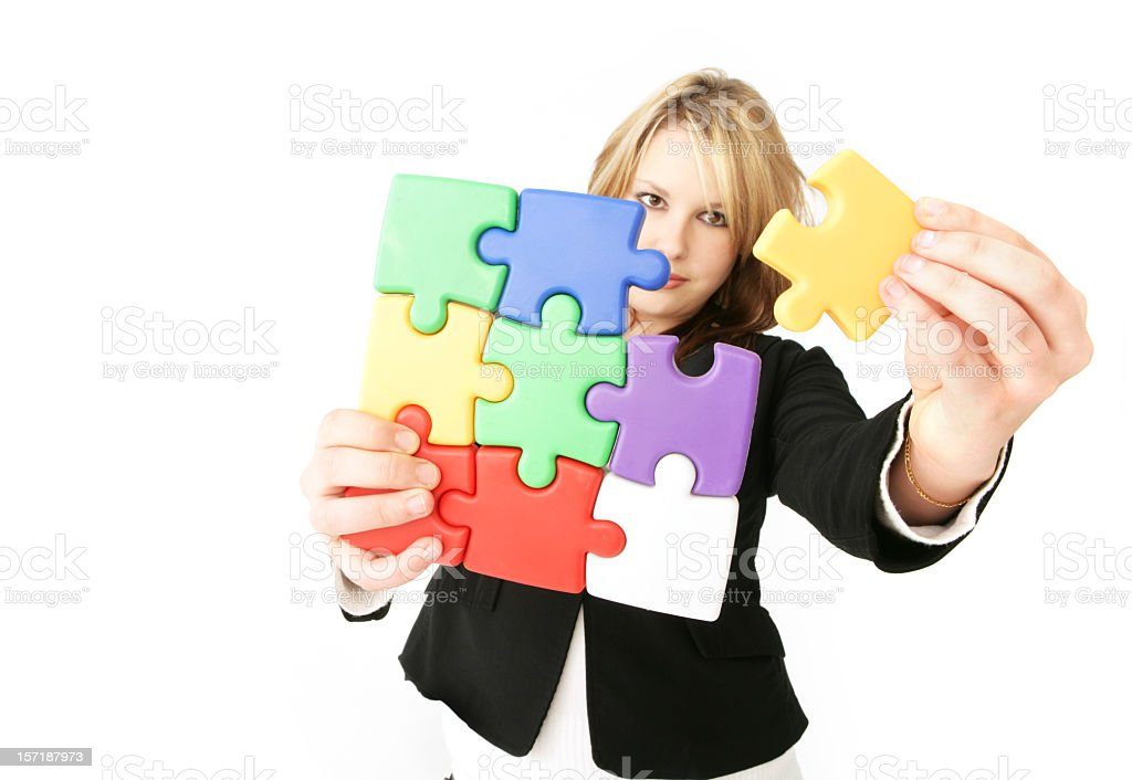 Finding a solution to a jigsaw puzzle royalty-free stock photo