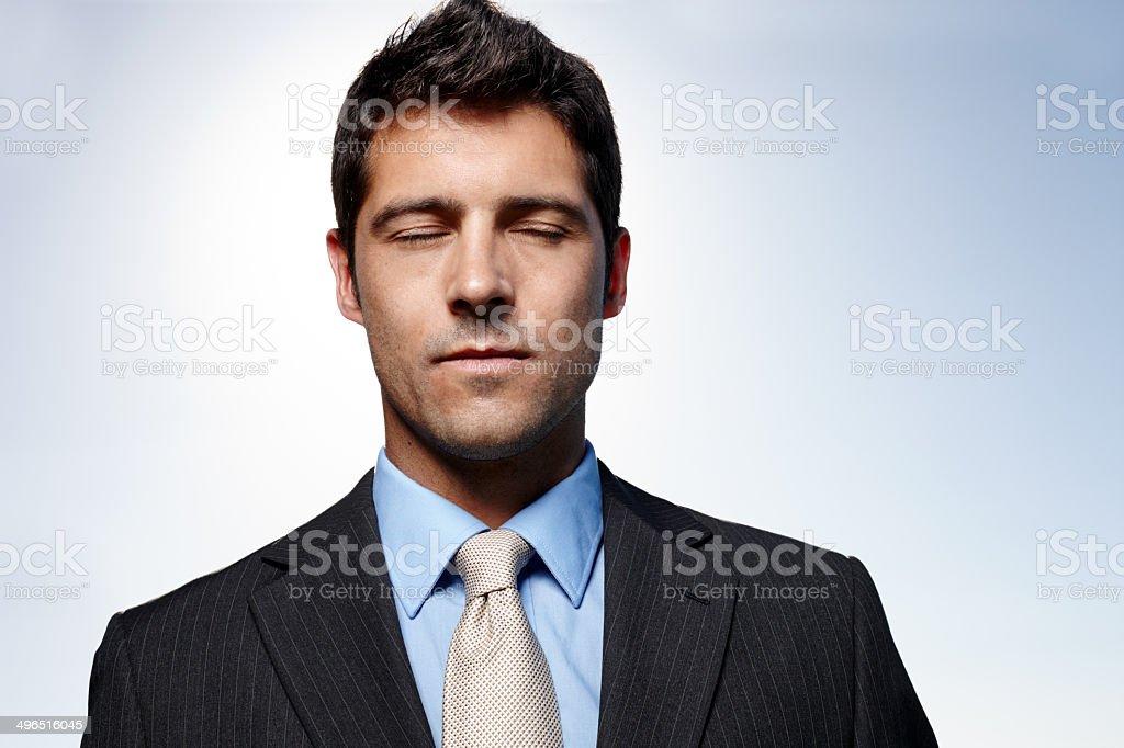 Finding his corporate zen stock photo