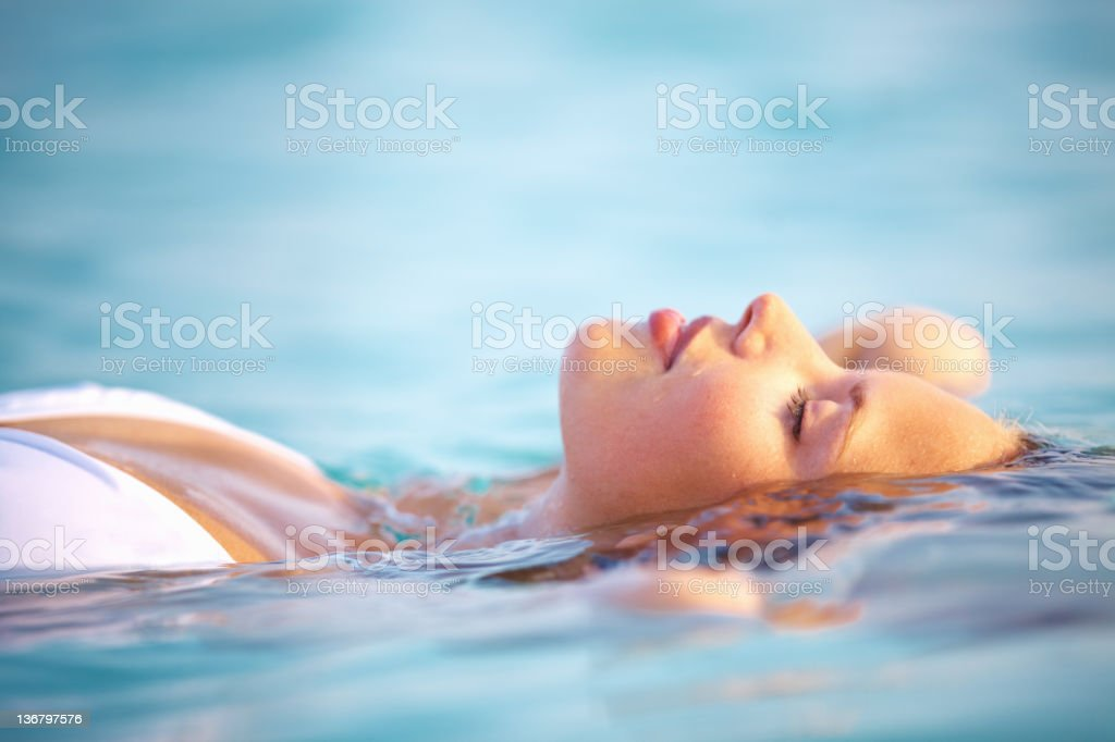 Finding peace in the summer waters stock photo