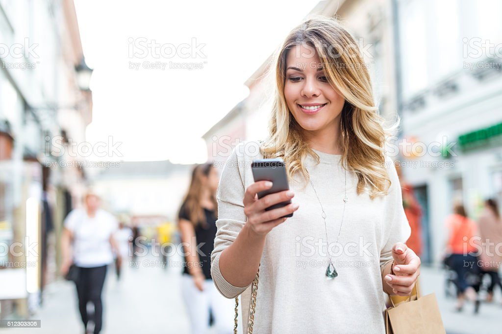 Finding shopping deals online stock photo