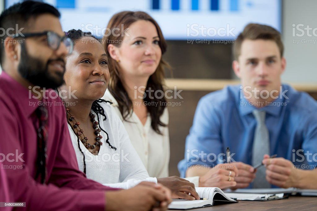 Finding Solutions During a Boardroom Meeting stock photo
