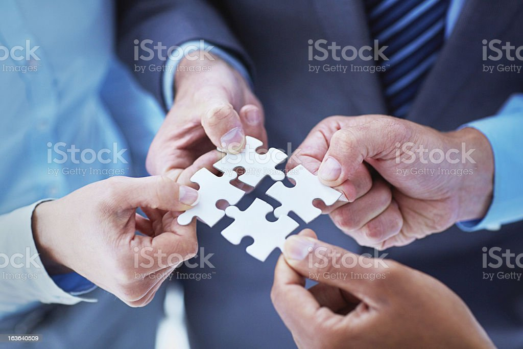 Finding solutions through teamwork stock photo