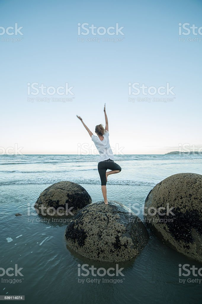 Finding the balance, the spirituality. Yoga by the sea stock photo