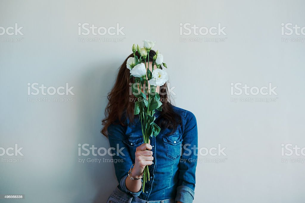 Finding the meaning behind the flowers stock photo