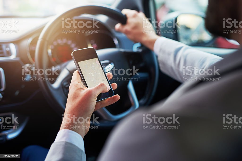 Finding the quickest route with his phone stock photo