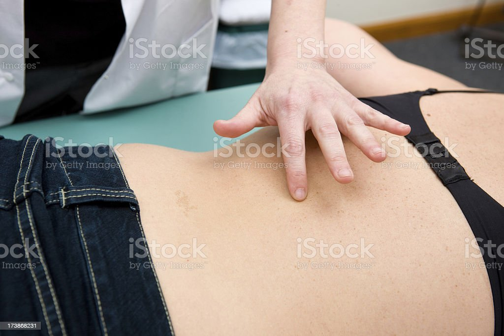 Finding The Right Place For Acupuncture royalty-free stock photo