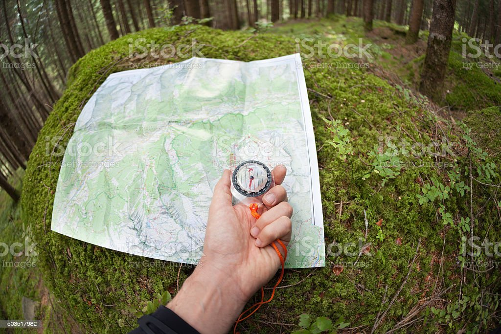 finding the right position with a map and compass stock photo
