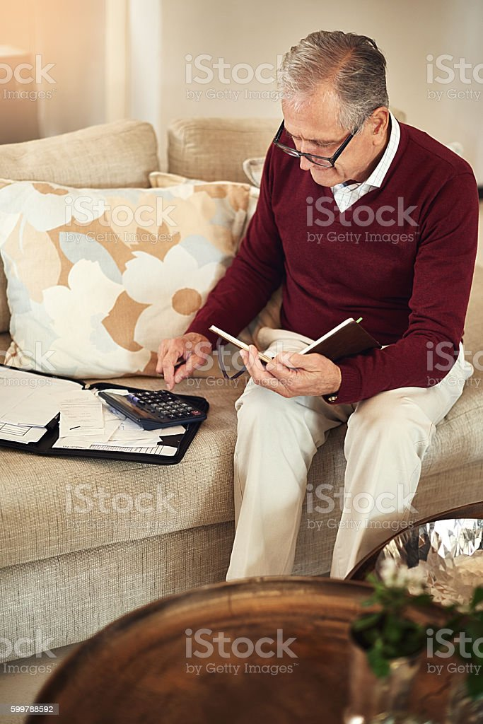 Finding ways to make his existing savings last stock photo