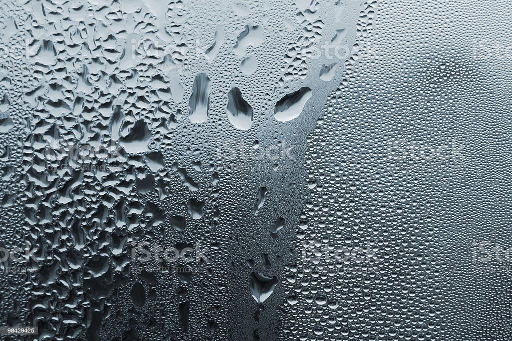 Fine and large water drops on window royalty-free stock photo