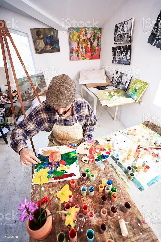 Fine art artist in his workshop-vertical stock photo