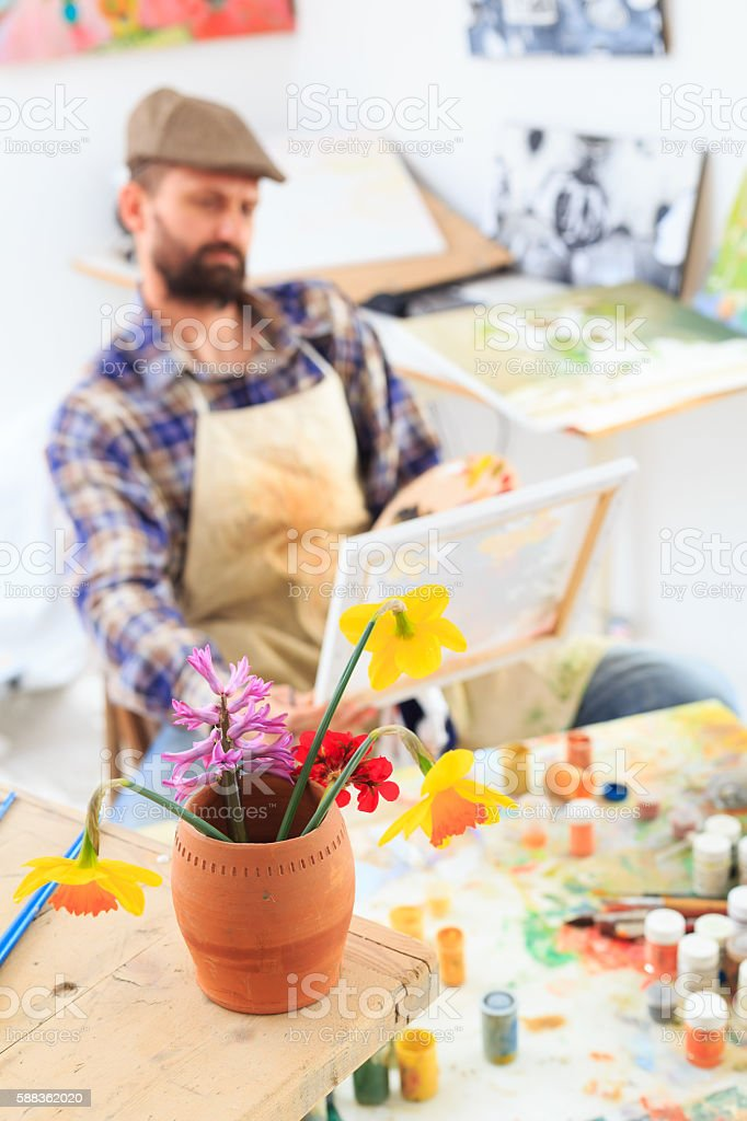 Fine art artist painting at his workshop stock photo