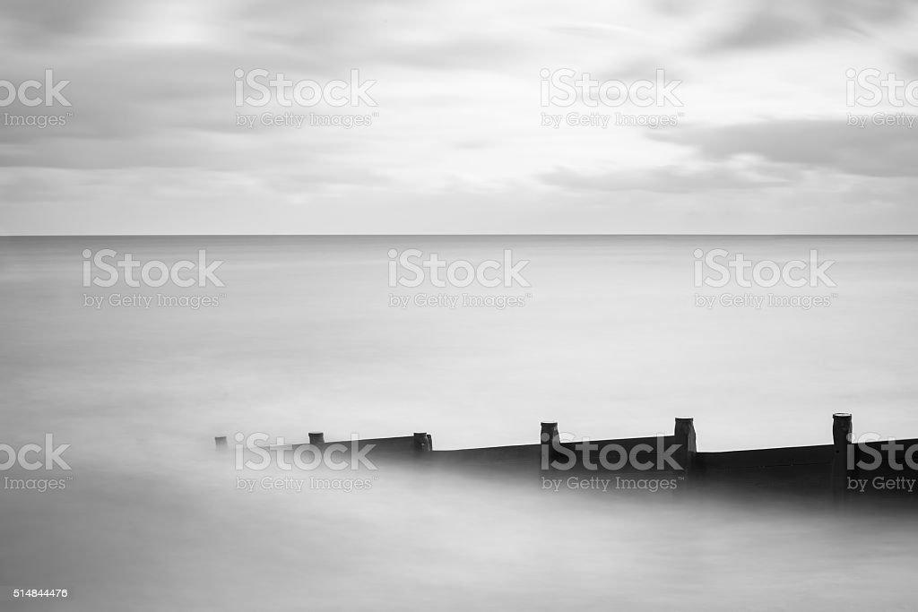 Fine art landscape image of sea in black and white stock photo