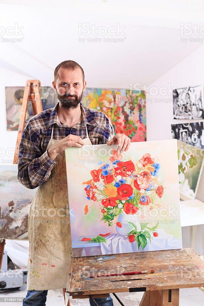 Fine art painer showing his artefact stock photo