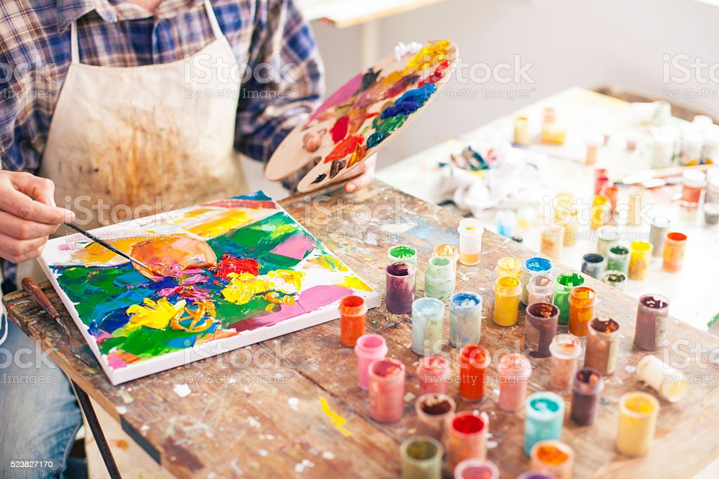 Fine art painter creating a new masterpiece stock photo