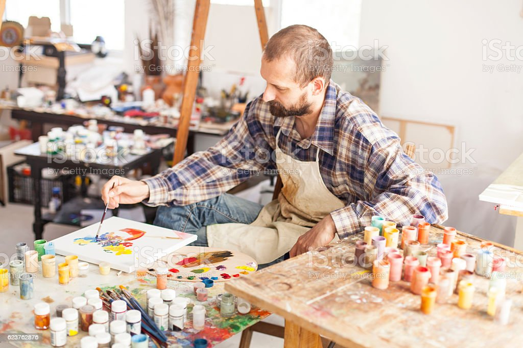 Fine art painter creating new artwork-hight angle view stock photo