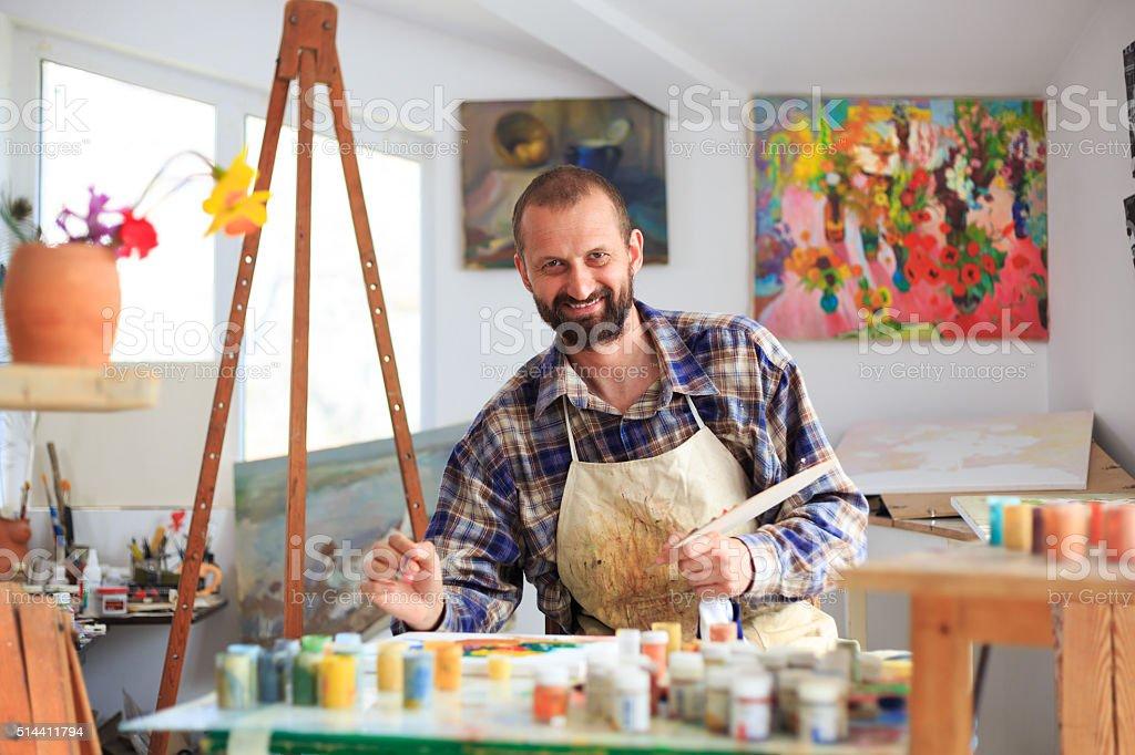 Fine art painter in his workshop stock photo