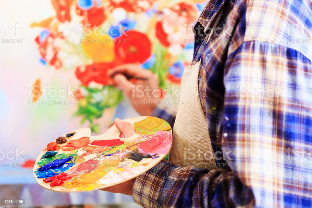 Fine art painter working at his workshop stock photo