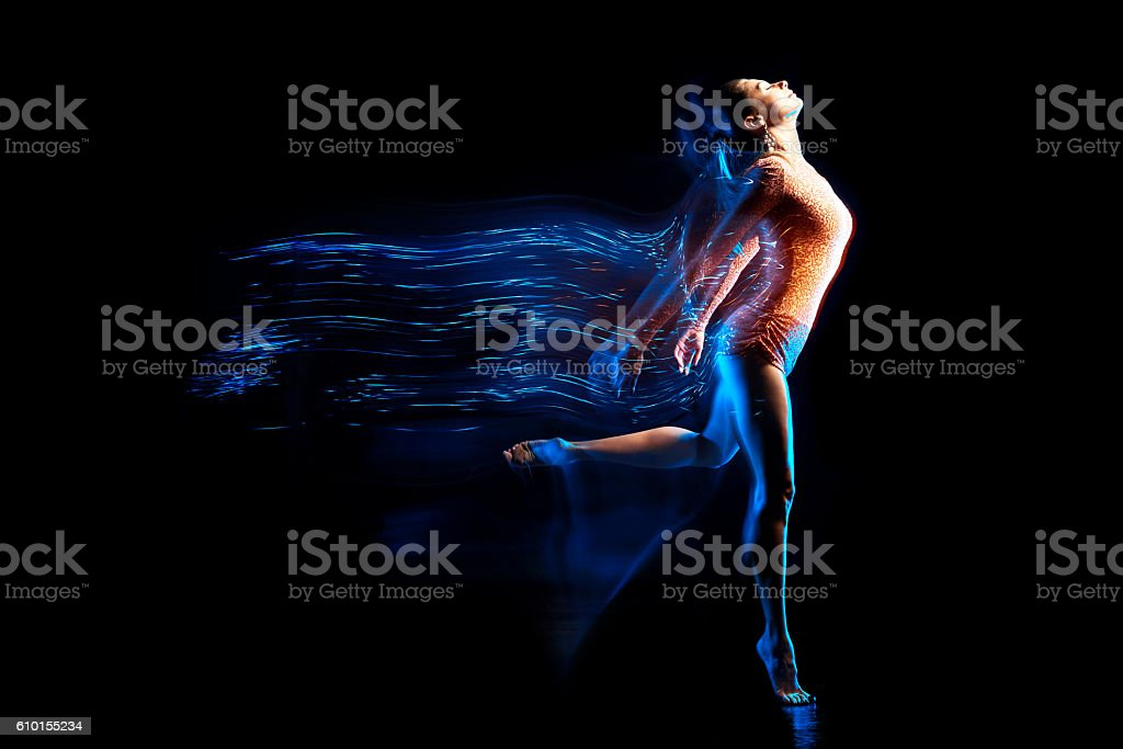 Fine art portrait of beautiful woman dancer in blue sparkles stock photo