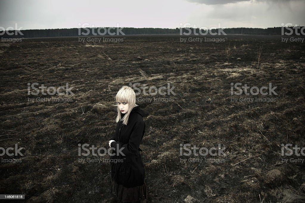 Fine art portrait of girl on black field royalty-free stock photo