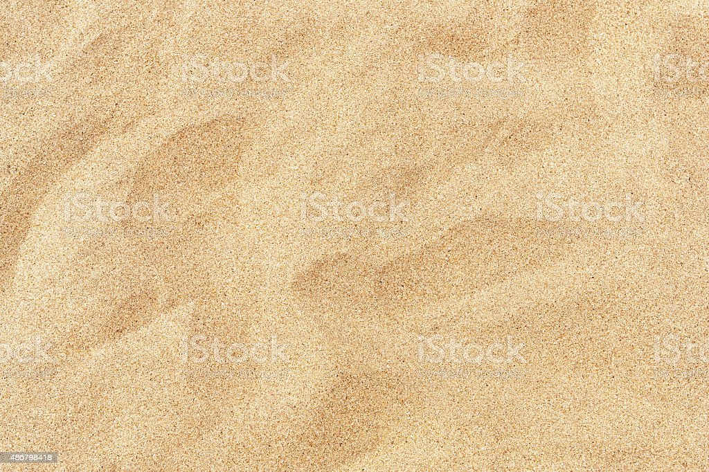 Fine beach sand in the summer sun stock photo