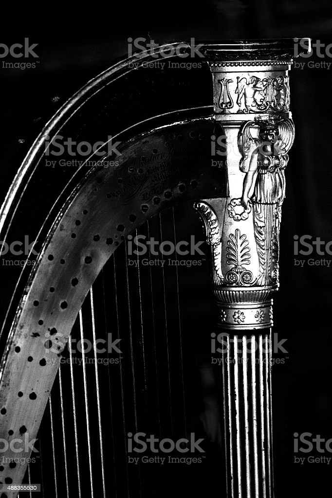 Fine black & white detail of an old gold harp stock photo