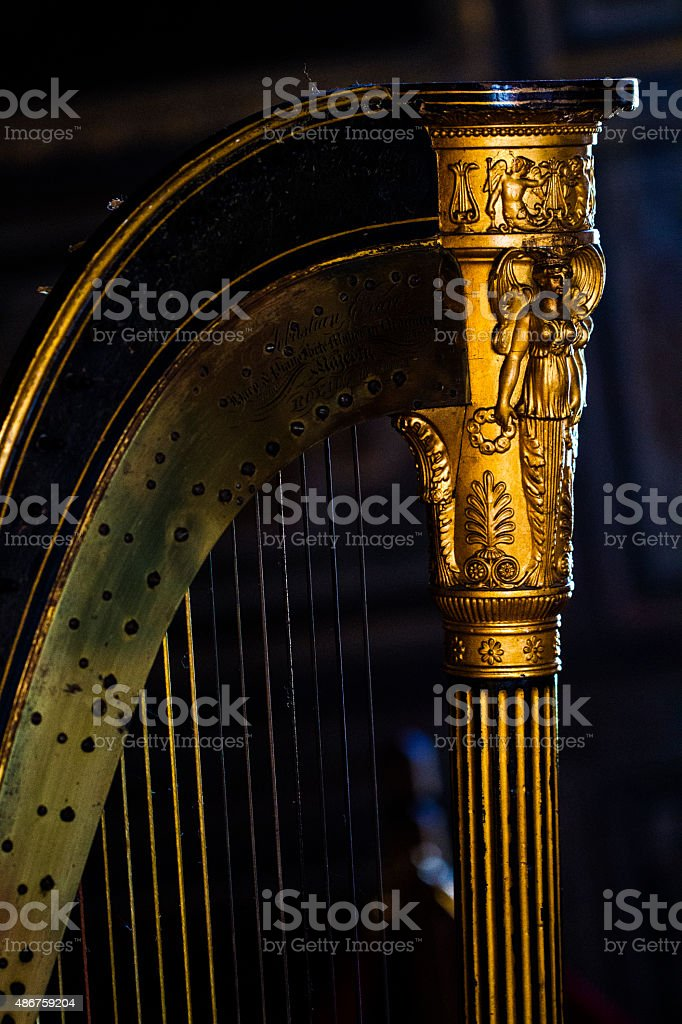 Fine colour detail of an old gold harp stock photo