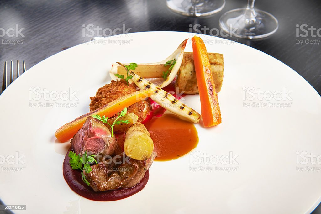 Fine dining gourmet meal with meat and carrots stock photo