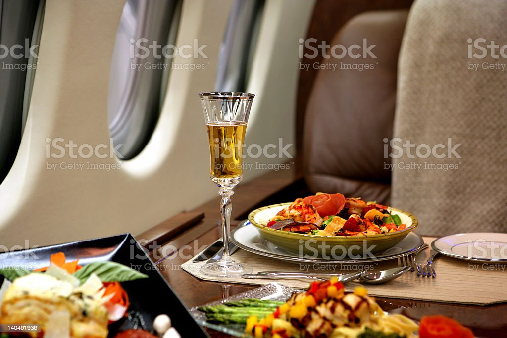 Fine dining in a luxury private jet stock photo