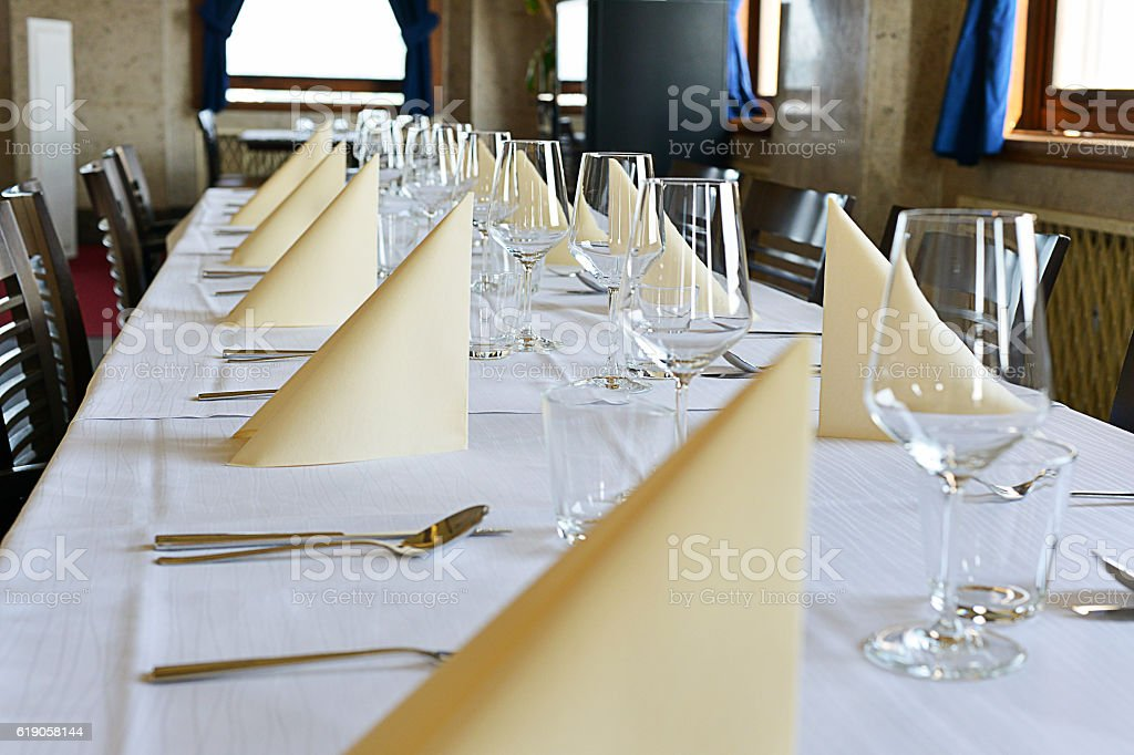 Fine Dining Restaurant Dinner Table Place Setting, Napkin & Wineglass stock photo