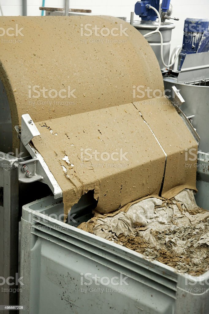 Fine filtration fermented wine in a tumbling filter system stock photo