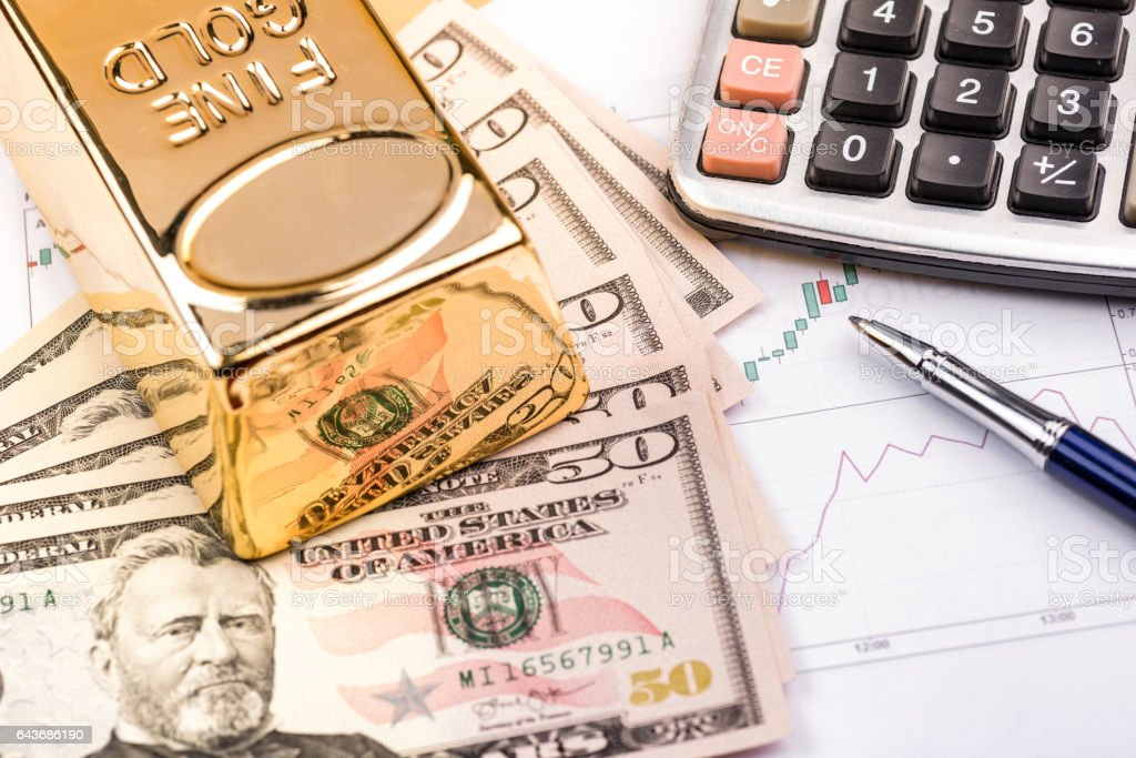 Fine gold bars and Dollars stock photo