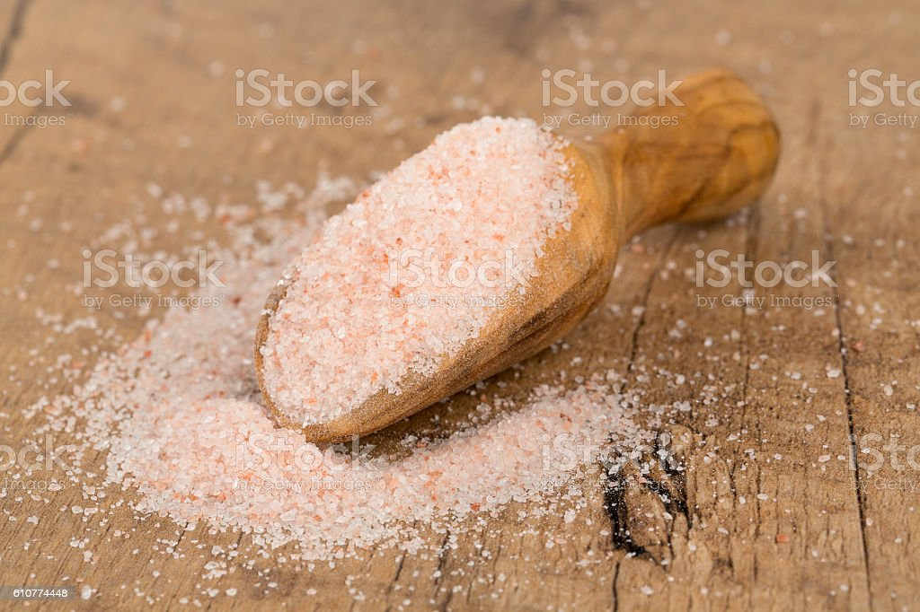 fine himalayan salt in a wooden scoop stock photo