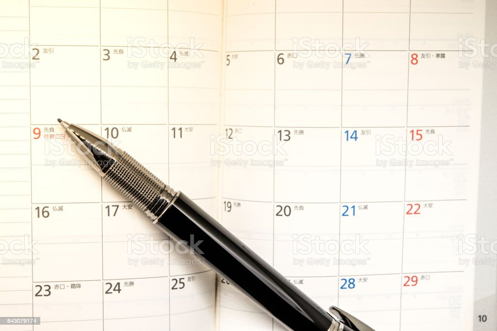 Fine liner pen on diary planner book. stock photo