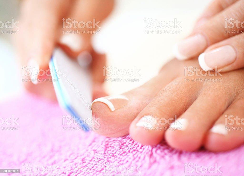 Fine pedicure treatment. stock photo