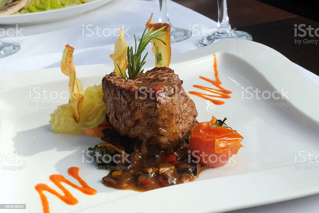 Fine restaurant dinner table place setting: beef stock photo