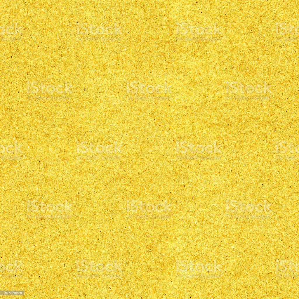 Fine seamless grained sparkle glossy gold sheet of handmade paper stock photo