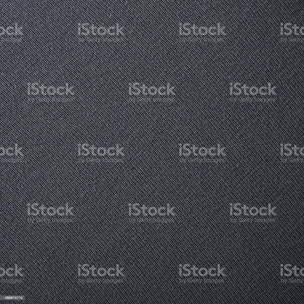 Fine woven dark blue repeatable fabric texture background stock photo