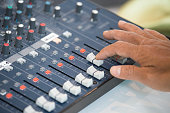 finger addjust on audio mixing console