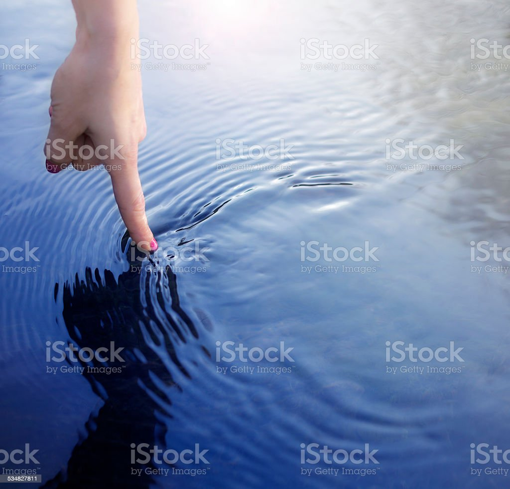 Finger and water stock photo